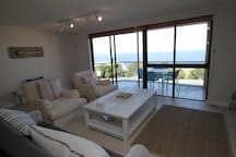 living room walks out on a balcony with braai area