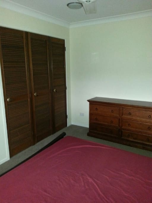 Bedroom has wardrobe and dresser space