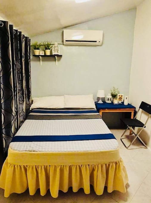 Common room with 1.5 hp split type inverter Daikin a/c, lamp shade,wall fan, emergency light,wardrobe. A double size bed with pillows,blankets & bolster, electric iron & an ironing board