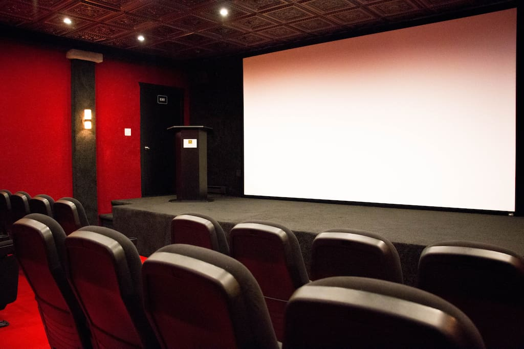 Theater room with stage, 17 foot screen, stadium seating for 38 and commercial equipment!
