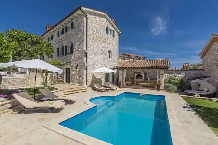 Stone holiday home with private pool and fenced garden near the water park