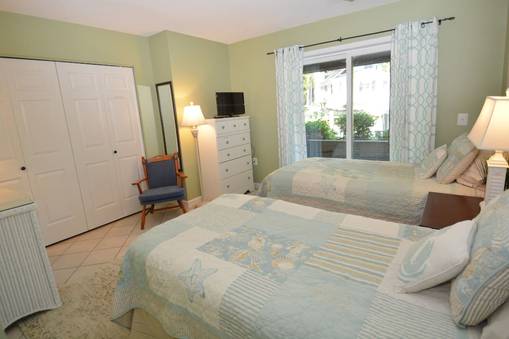 Bedroom 1 - Dresser, closet. And a large sliding glass door that opens to your waterfront patio.