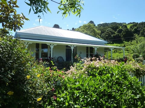 Halfmoon Cottage at the end of  Akaroa harbour.