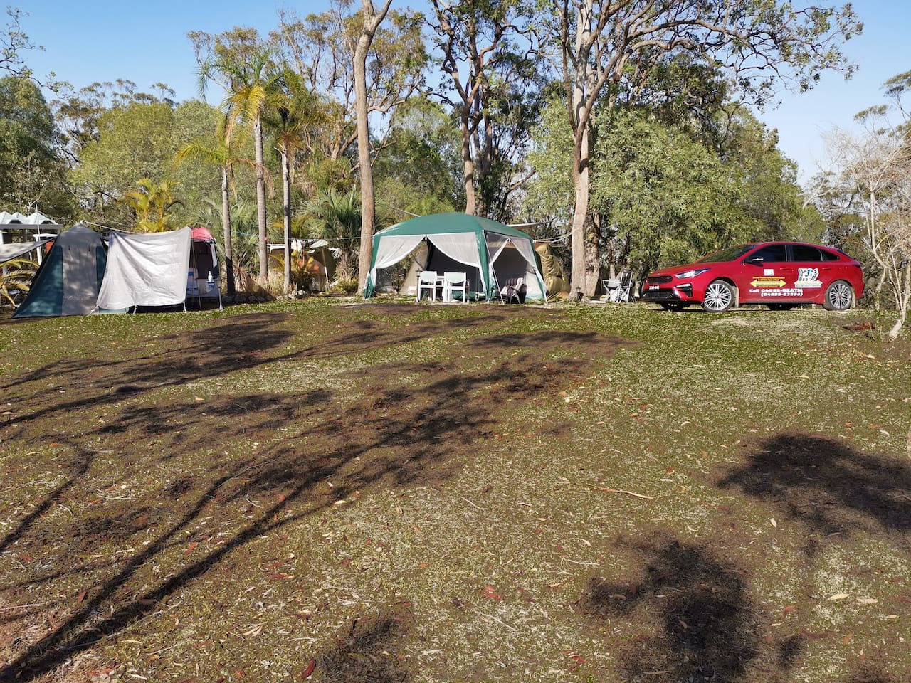 Expanded Facilities at Campground with additional 2 Man Tent, Large Pergola & extra Shower Tent. However, due to extreme drought the grass is not as green as shown here