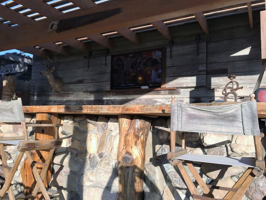 outdoor patio and bar with big screen TV