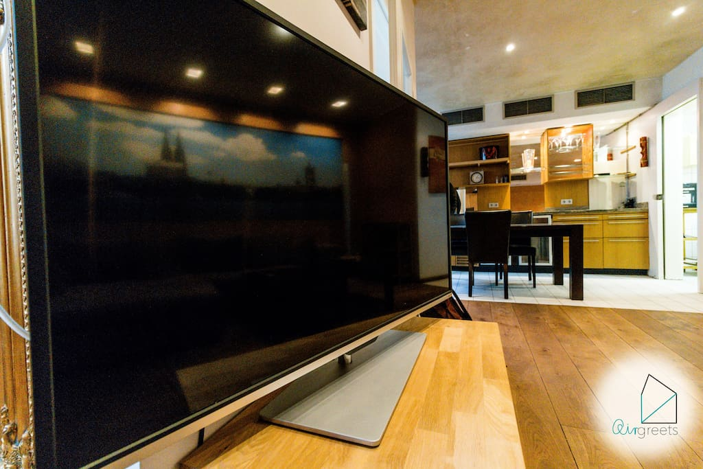 Relax by watching a good movie on the large & modern TV!