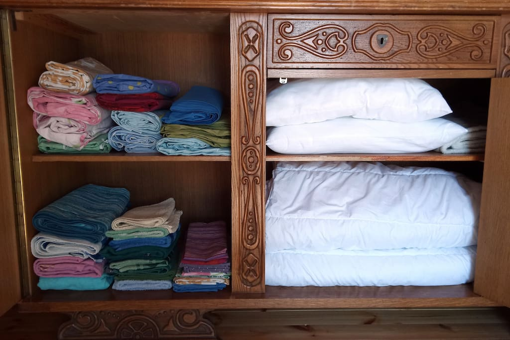 Linen, towels, pillows and blankets in the storage.