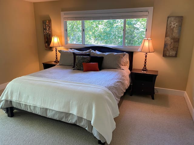 Master Suite #2 - on 2nd floor - direct access to deck overlooking the creek.