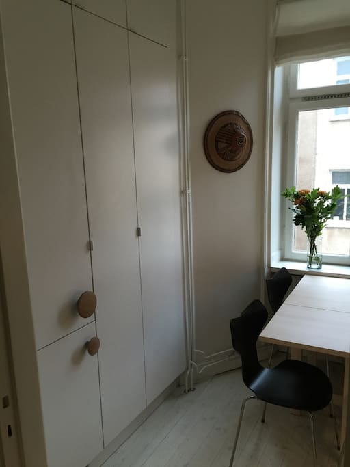 Large fridge and freezer, kitchen table with four chairs