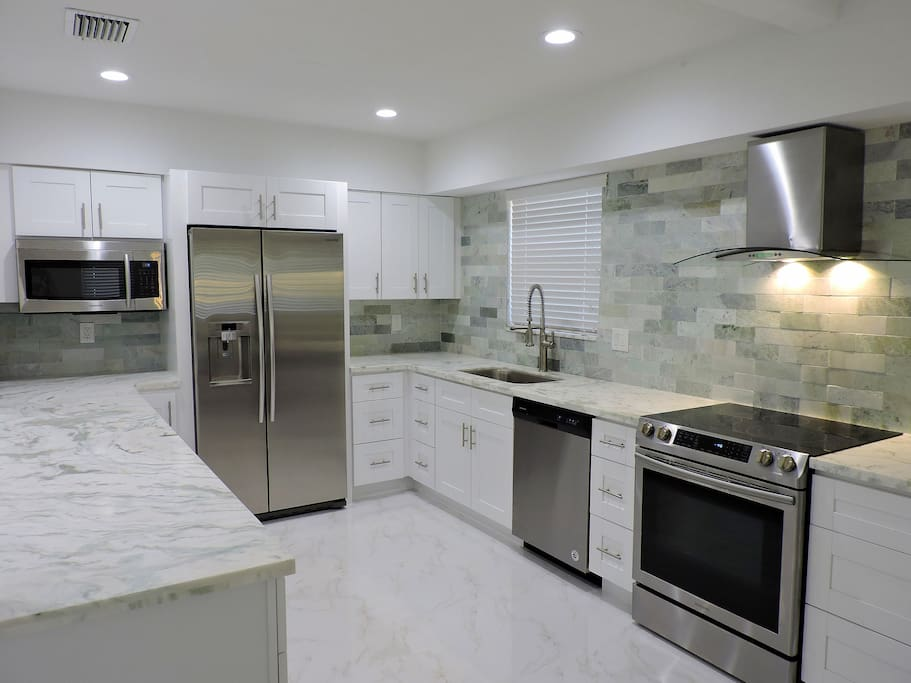 STUNNING ALL NEW KITCHEN WITH MARBLE COUNTER TOPS AND BACK SPLASHES