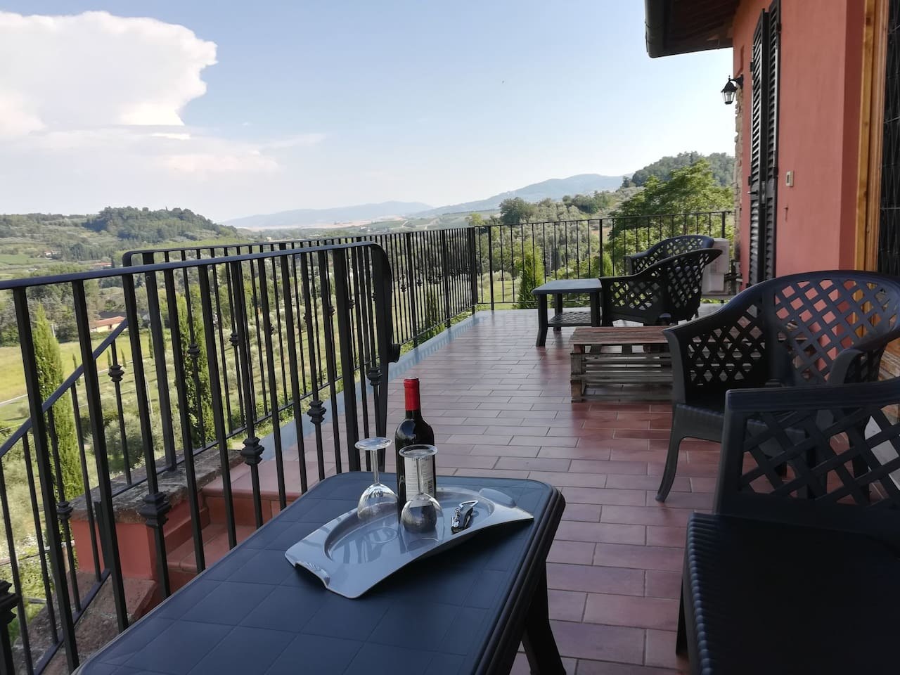 Enjoy a glass of wine admiring our Tuscan landscape