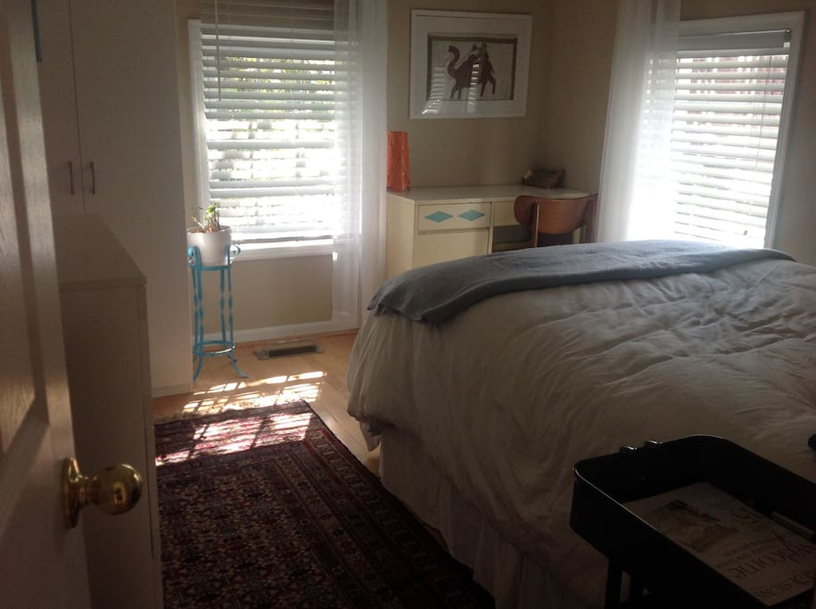 Charming, cozy, quiet and light-filled bedroom with an incredibly luxurious bed.