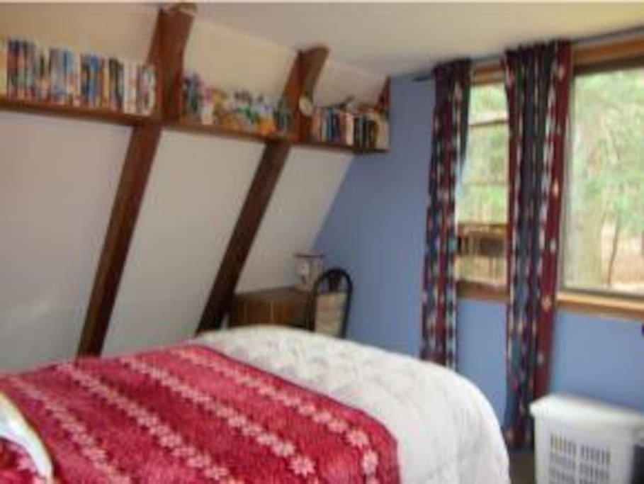 master bedroom w/ large picture window overlooking pond/woods