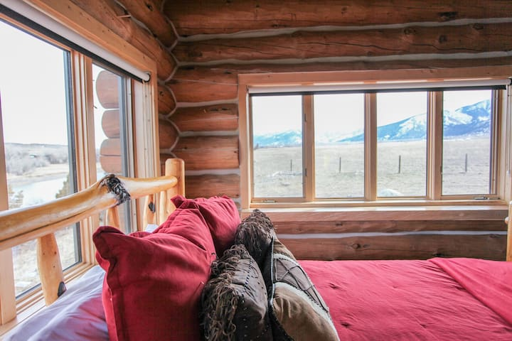 Main level bedroom with queen bed off of the kitchen area - beautiful river views and door to the deck