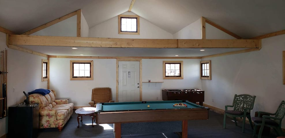 BRAND NEW optional game room in converted garage.  Available for an additional fee ($50 total for entire duration of your stay, no matter how many guests or nights).  Pool table, pinball (soon), foosball, beer pong, mini fridge, bluetooth, couches.