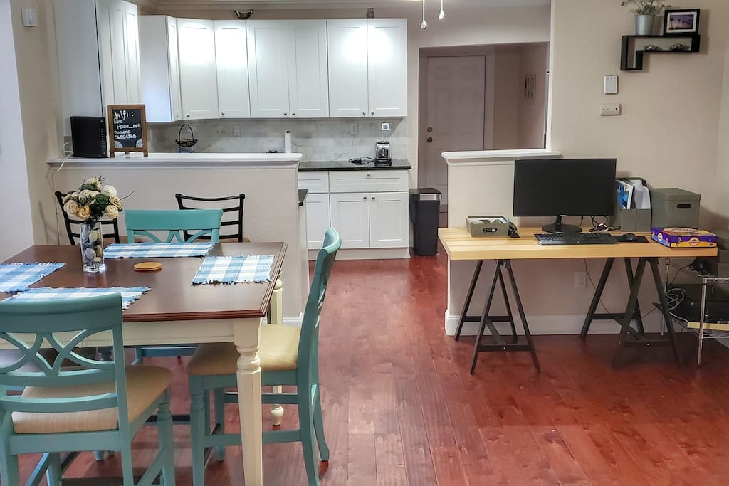 Dining room with extendable table and work area.