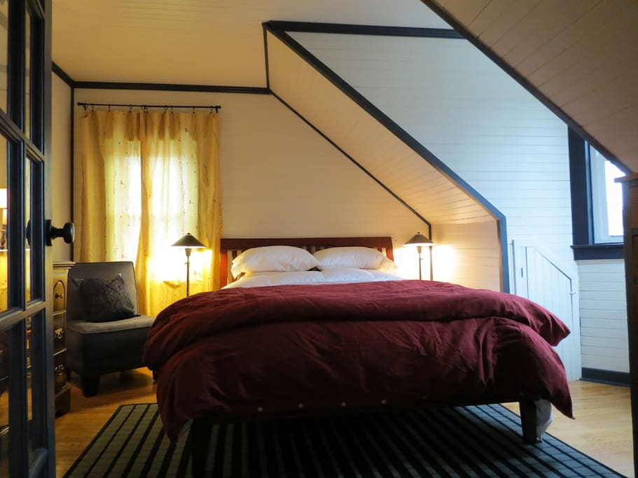 Queen Bed with TV and comfy pillows & comforters.  French Door with Privacy Shade