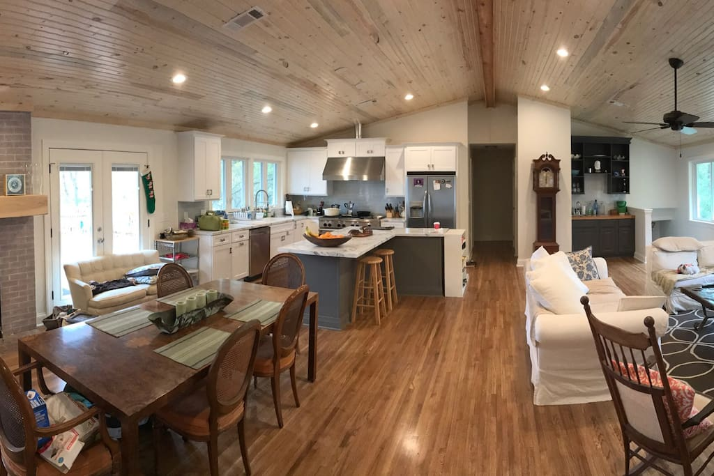 Spacious open floor plan with living room, dining room, and kitchen.