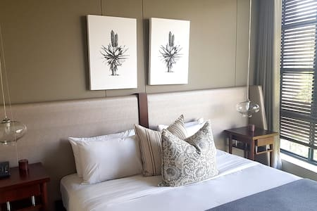 Master bedroom. Soothing modernist interior with sumptuous bedding.