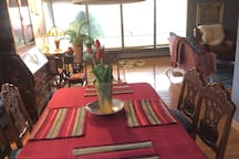 Natural daylight dining room with thoughtful touches of fresh flowers