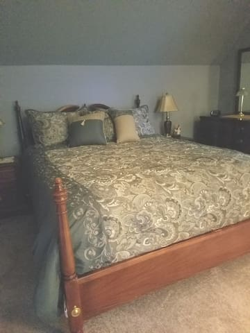 Queen bed in newly refinished room.  New bedside lamps and bed linens.