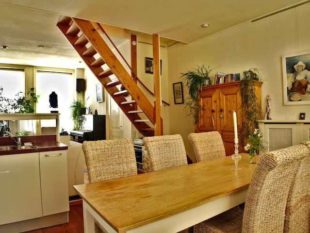 The dining table as part of the open kitchen. You can see the stairs toward the second floor and the 2 bedrooms