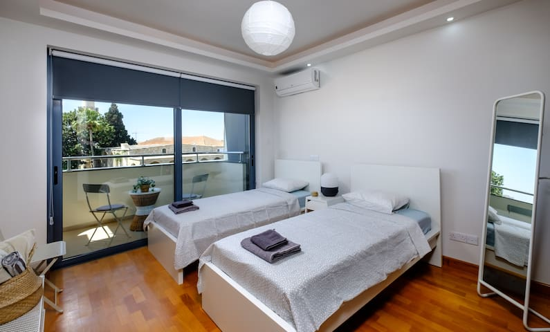 Bedroom No.2 with two single beds and a balcony