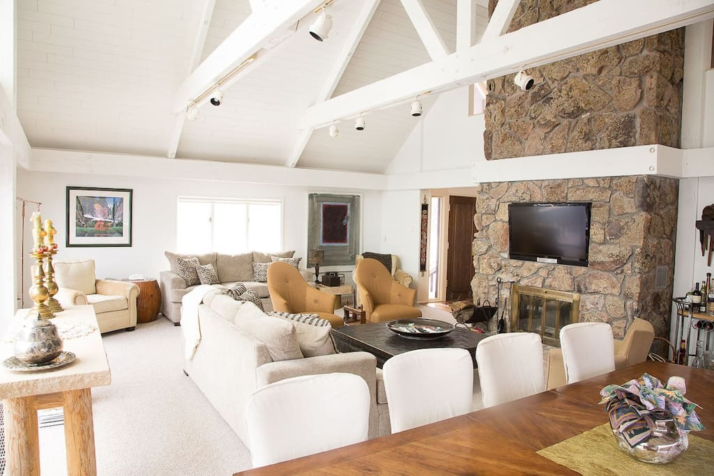 Spacious, high-ceilinged living area with plenty of seating for everyone.