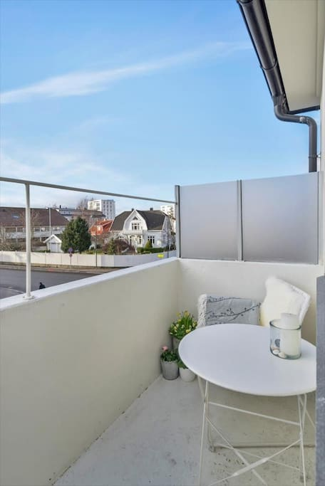 Today the balcony has a small couch + chair (room for 3 people) and barbecue grill