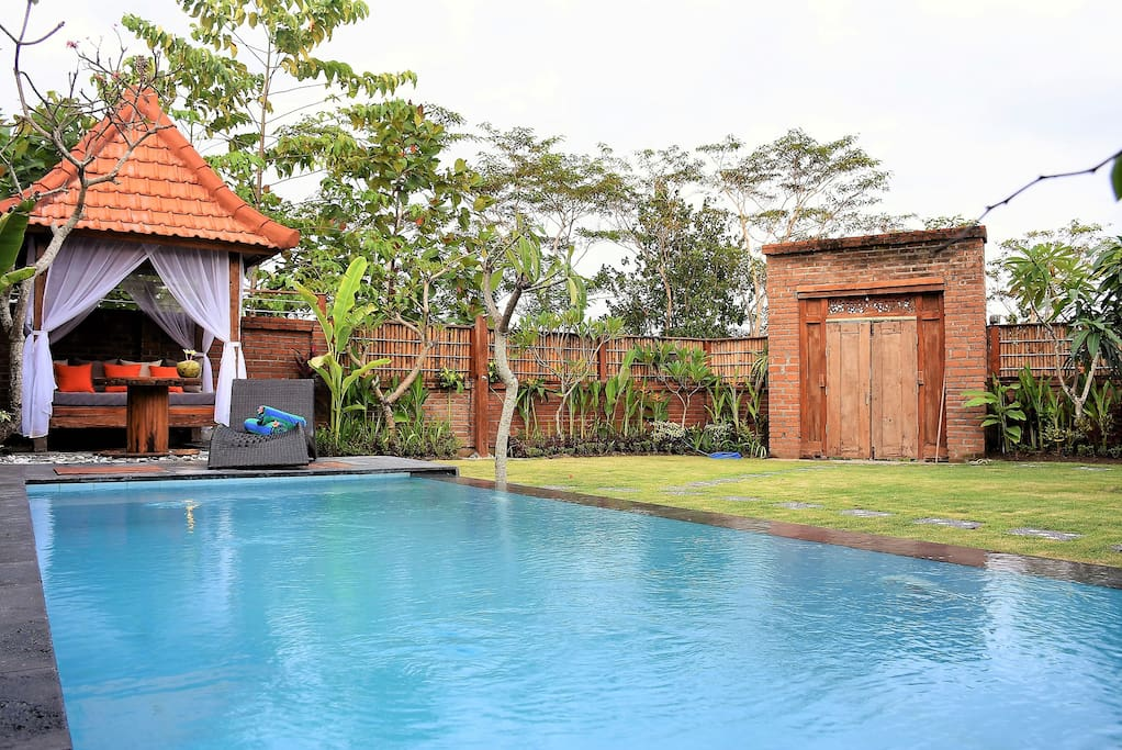 Large tropical garden with swimming pool and gazebo