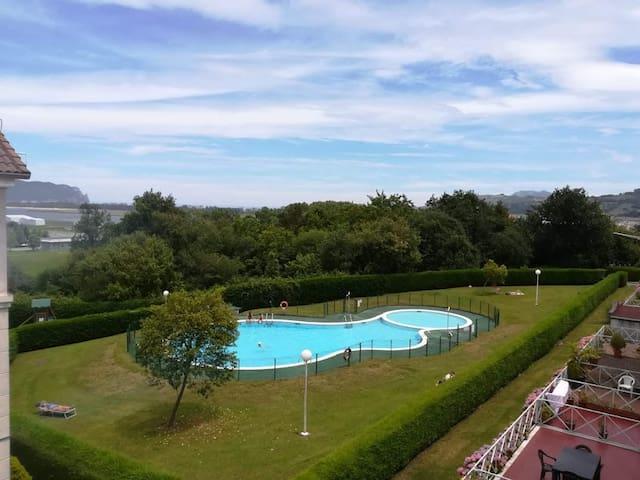 Duplex con piscina TRETO