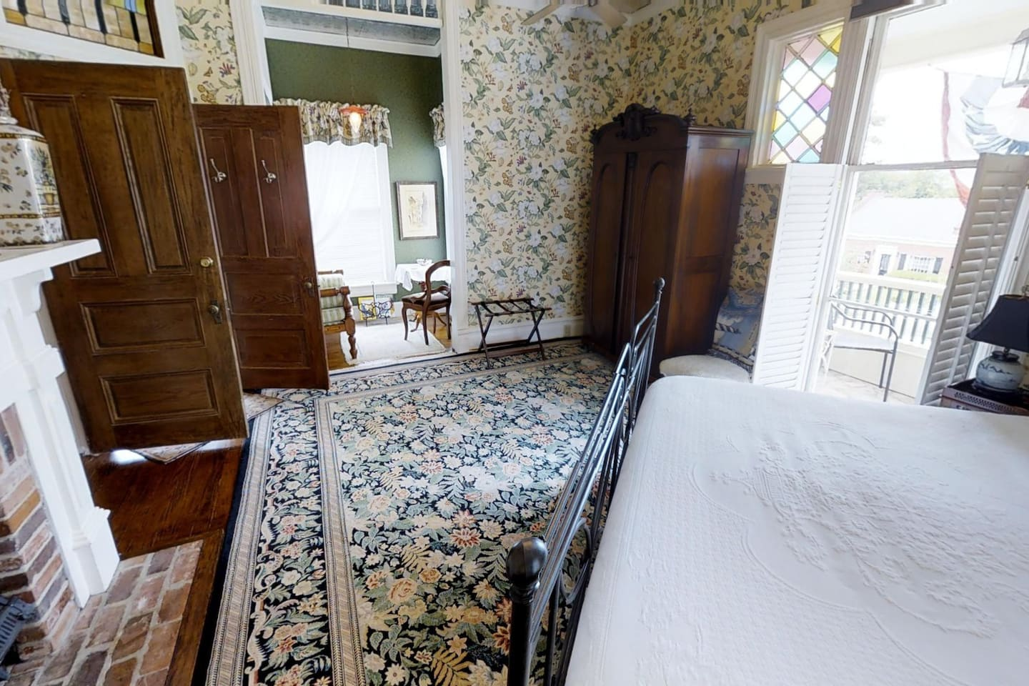 German Mill Room has a king. bed, private bath with spa tub, separate shower sitting area, and balcony