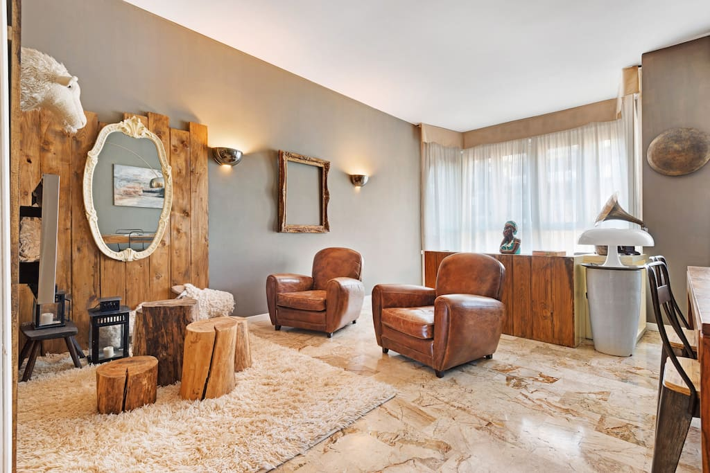 The living room   here: the armchairs, the dining table & the relax area