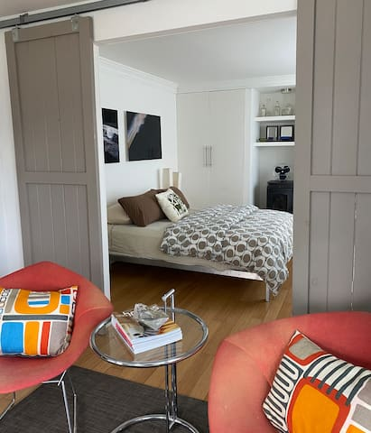 First floor Bedroom with Queen size bed, barn doors and small seating area
