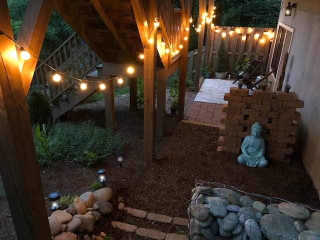 The ZEN DEN comes alive at night with solar lights, festive patio lights and fireflies!