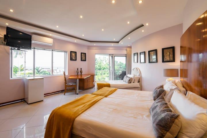 Bedroom 5 en-suite and has a balcony.