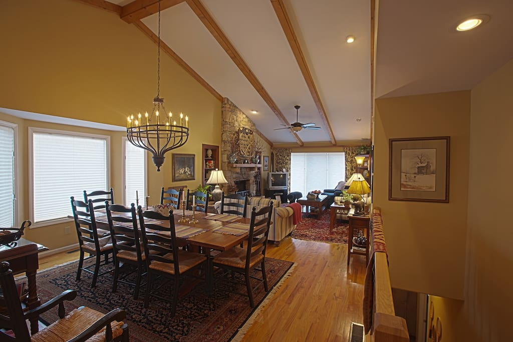 The spacious dining area with bay window has a large farm-style table with comfortable seating for parties of eight to ten.