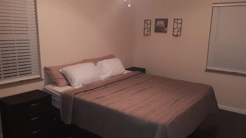 Bedroom 3 California king with nightstands