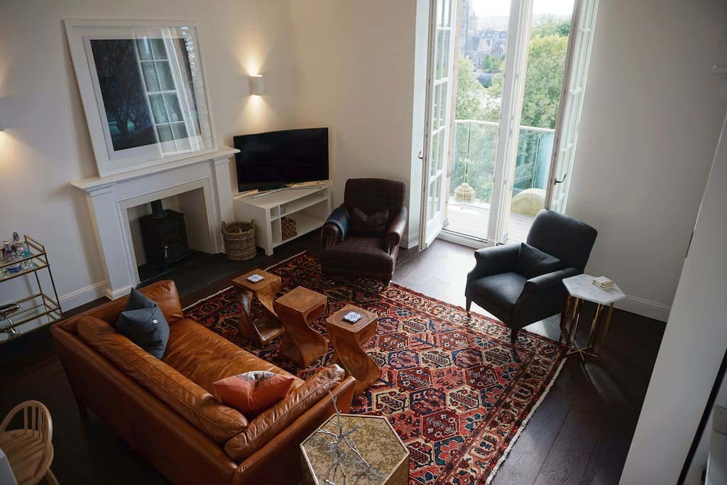 Relax in the comfortable living room with river and city centre views