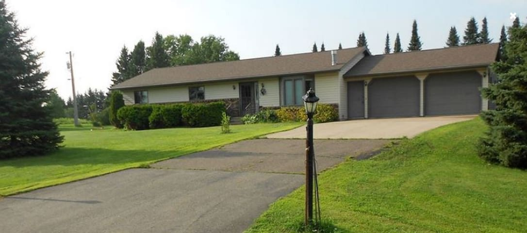 House is on a large lot in a quiet neighborhood on the edge of town, set back from the street.