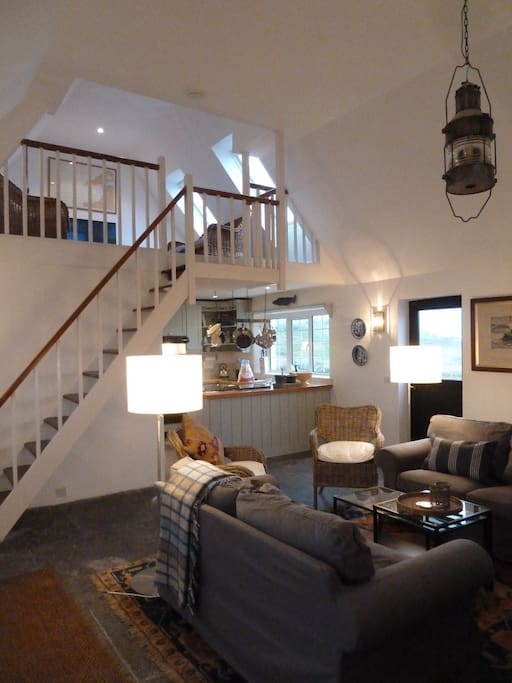 Main living space with loft above