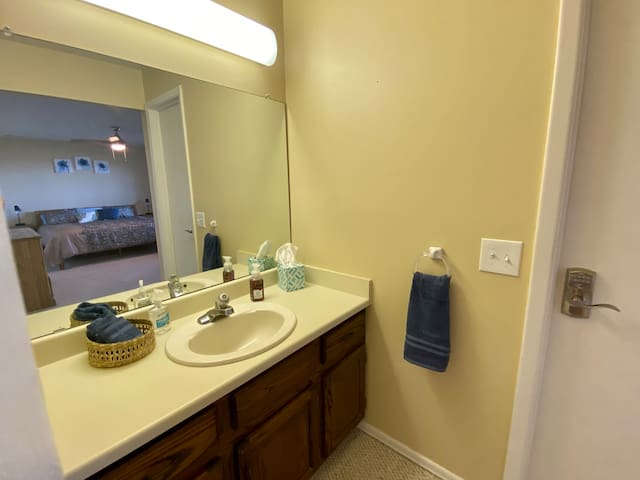 The private master bedroom sink area provides extra space for guests to get ready for the day.