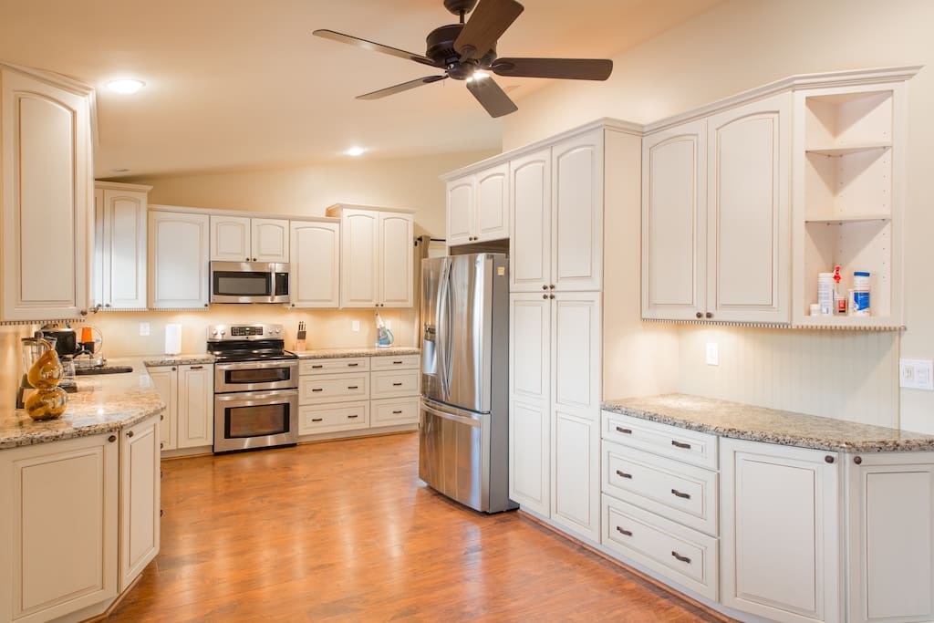 Open concept kitchen. Comes fully stocked with everything you need to cook a family meal.