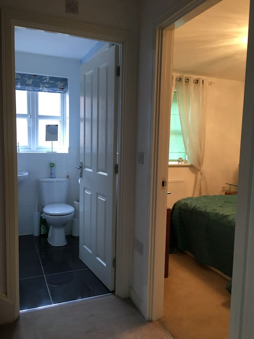 Private bathroom adjacent to bedroom