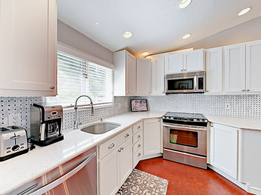 Ample cabinet space and high-end fixtures in the kitchen.