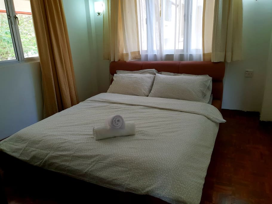 Bedroom with clean sheets, pillows and towels in the cupboard to use during stay only.