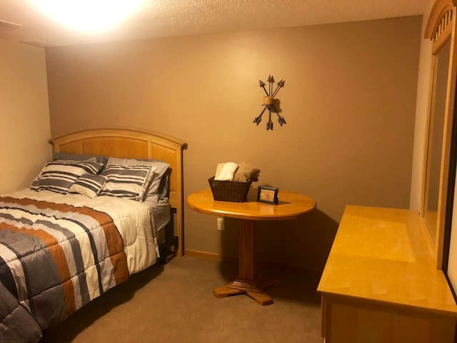 Bedroom - queen bed, closet, table, dresser, ironing board, extra blankets and pillows