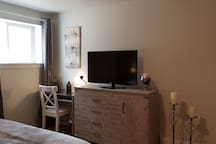 Large bedroom has a work area, dresser for your use and TV with Netflix, battery powered candles for a relaxing  feel.