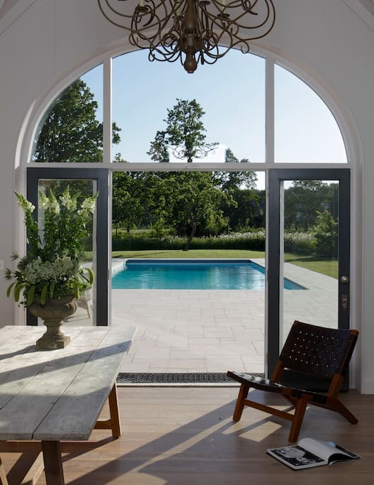 The newly built pool house is the perfect place to unwind on a summer evening
