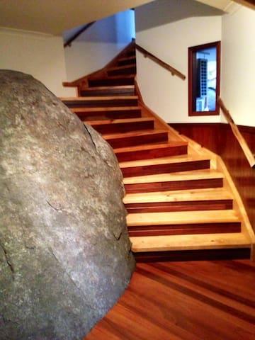 Staircase built into natural rock boulder